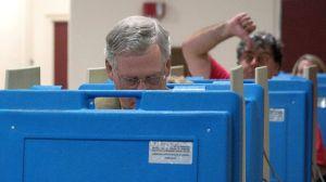 Voter photobombing Mitch McConnell, via abcnews.com
