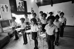 "1971 - Oakland, California, USA: Black Panther children in a classroom at the Intercommunal Youth Institute, the Black Panther school. (Stephen Shames/Polaris) The Children's House, The Intercommunal Youth Institute and the Oakland Community School. In 1970, in Oakland, David Hilliard created the idea for the first full time liberation day school. This school, and its attendant dormitories in Oakland and Berkeley, was simply called the Children's House. This school concept, directed by Majeda Smith and a team of BPP members became the way in which sons and daughters of BPP members were educated. Staff and instructors were Black Panther Party members. In 1971 this school moved into a large building in Berkeley and then to the Fruitvale area of Oakland. The Children's House was eventually renamed the Intercommunal Youth Institute (IYI). Under the leadership of Brenda Bay, the IYI served BPP families and a few nearby families in the Fruitvale area, maintaining a day school program and dormitory with 50 children, for two years. The Black Panther Party was one of the most influential responses to racism and inequality in American history. The Panthers advocated armed self-defense to counter police brutality, and initiated a program of patrolling the police with guns and law books. Their enduring legacy is their programs, like Free Breakfast for Children, which helped to inspire a national movement of community organizing for economic independence, education, nutrition, and health care. Seale believed that ""no kid should be running around hungry in school,"" a simple credo that lead FBI director J. Edgar Hoover to call the breakfast program, ""the greatest threat to efforts by authorities to neutralize the BPP and destroy what it stands for."""